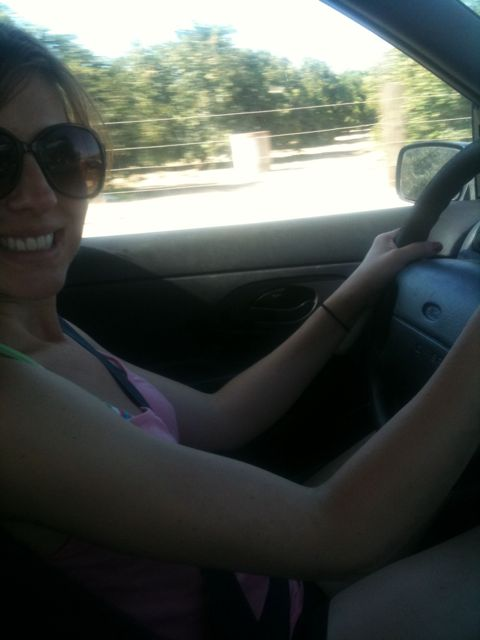 Tara driving a stick shift
